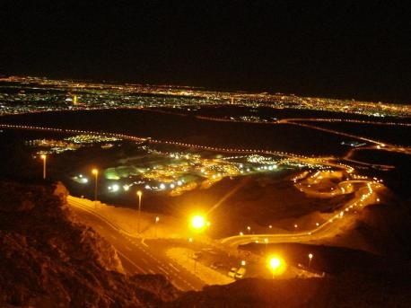 a view of Al Ain at night from the top of Hafeet