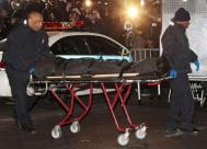 Heath's body taken out from his Manhattan apartment